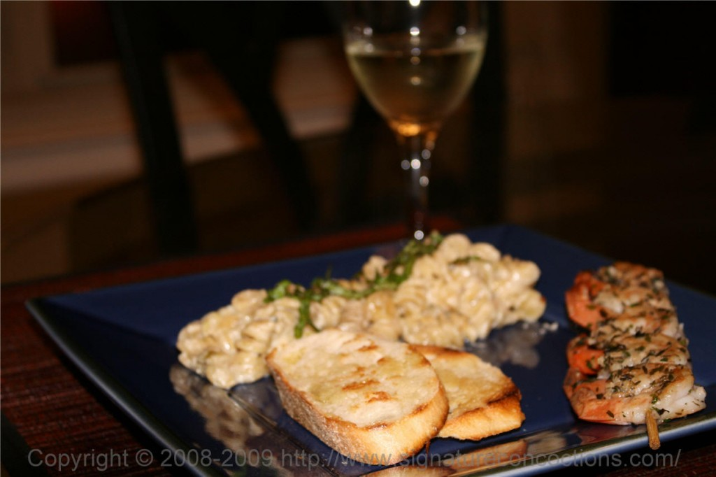 grilled herbed shrimp & pasta in alfredo sauce
