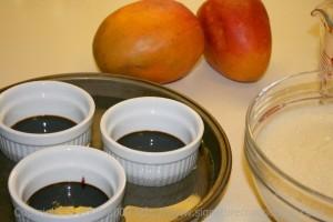 caramel lined ramekins and liquid custard